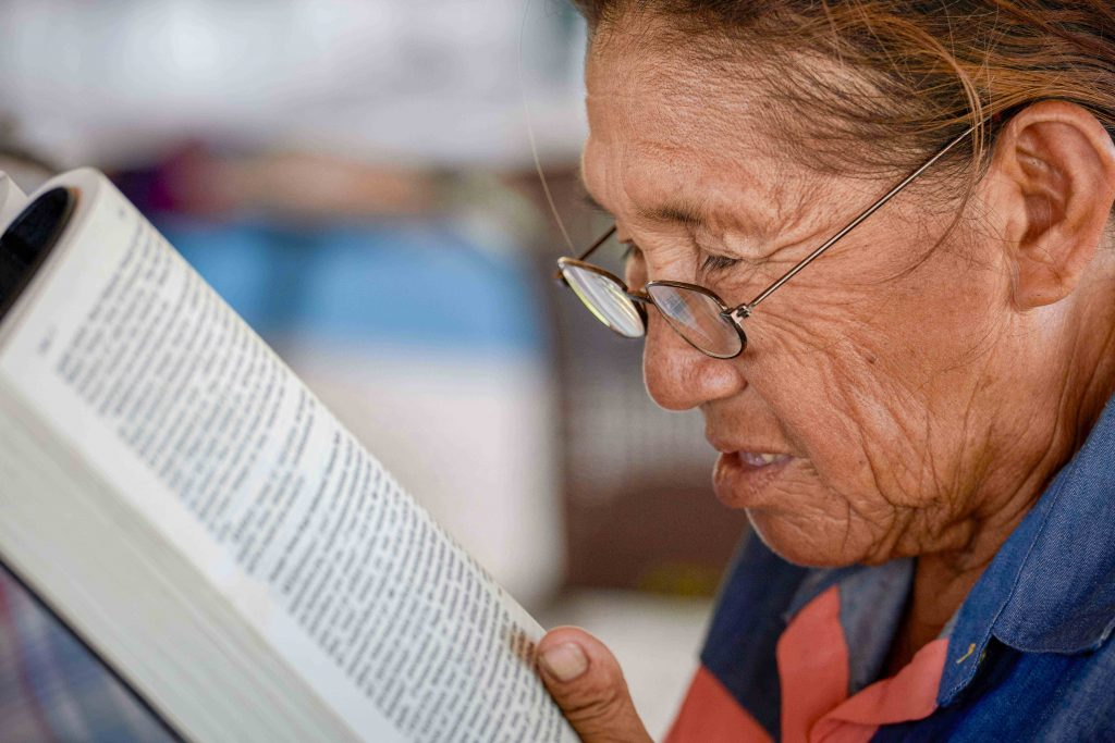 A woman reads the Bible during a workshop in St Ignatius, Guyana on 5 April 2019. The workshop was to help laypeople improve their reading of the Sunday Scriptures in their own languages, so they can better lead liturgies in their own indigenous communities. Photo: Paul Jeffrey/CNS.