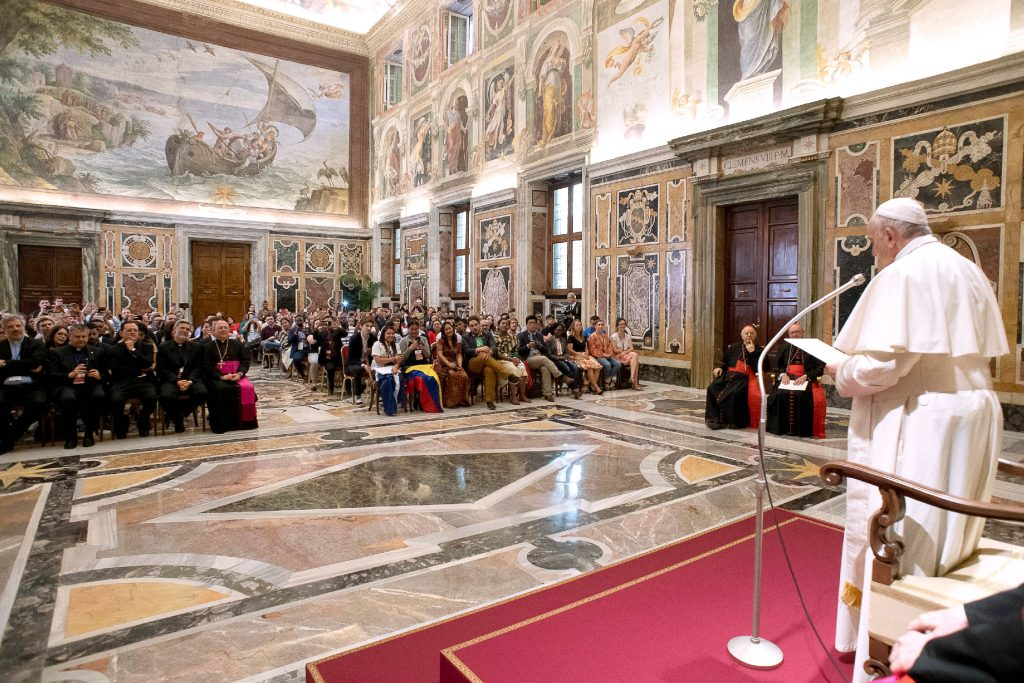 Pope Francis meets with participants attending the post-synod Youth Forum during an audience at the Vatican on 22 June. Photo: Vatican Media/CNS.