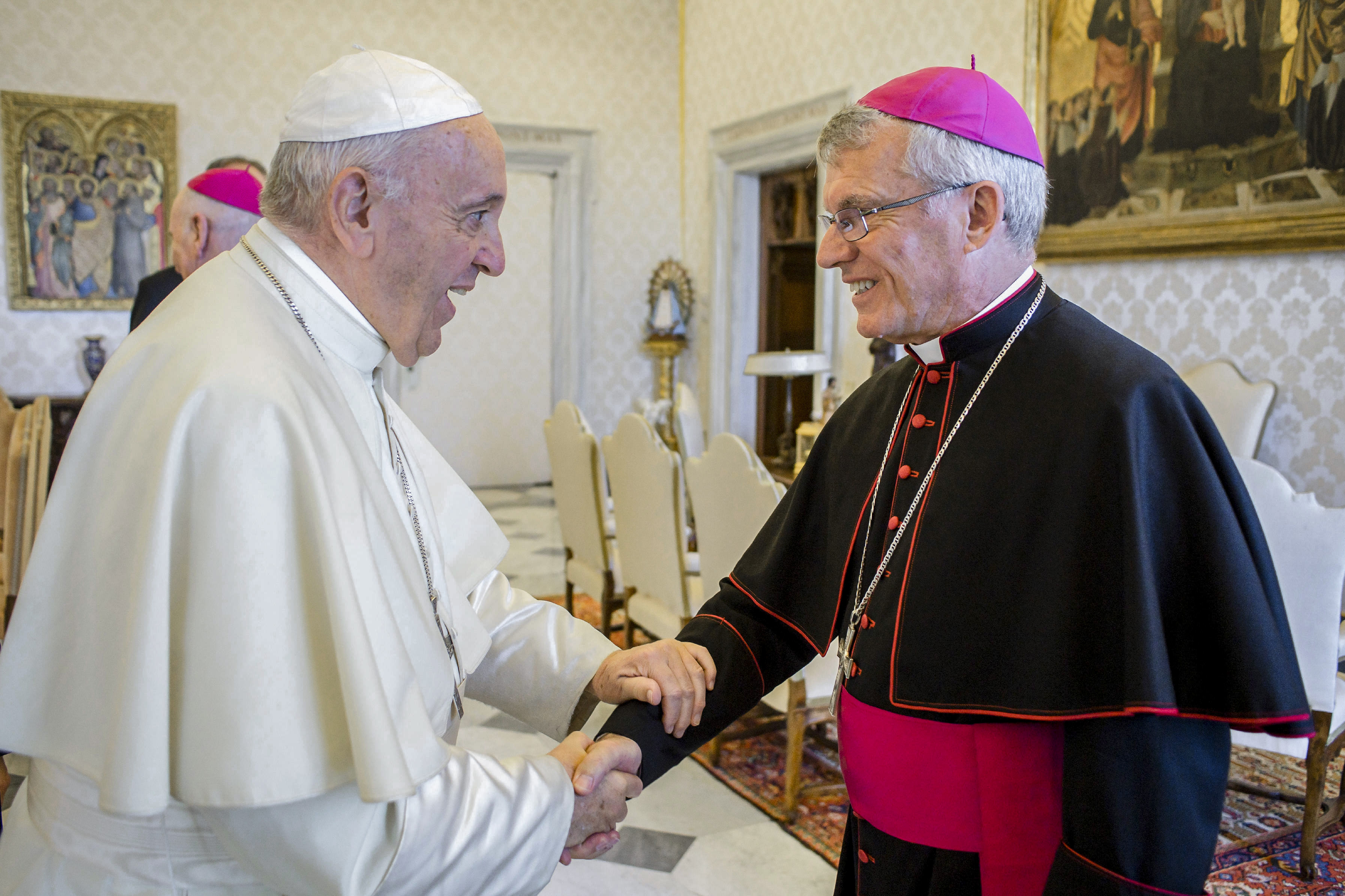 Pope Francis greets Archbishop Timothy Costelloe of Perth, Australia, during a meeting with Australian bishops on their