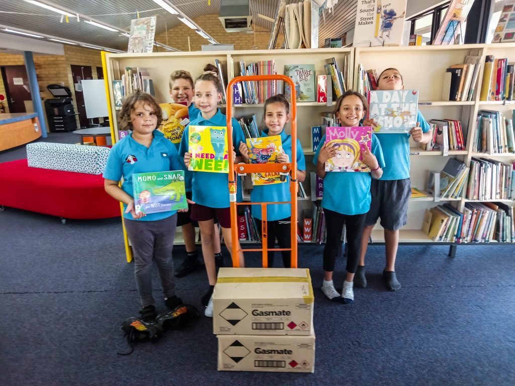 Some of the students from the Moorditj Noongar Community College are seen with school supplies that they are preparing for the Medjugorje Centre Inc as part of their efforts to help the poor in Africa. Photo: Supplied.