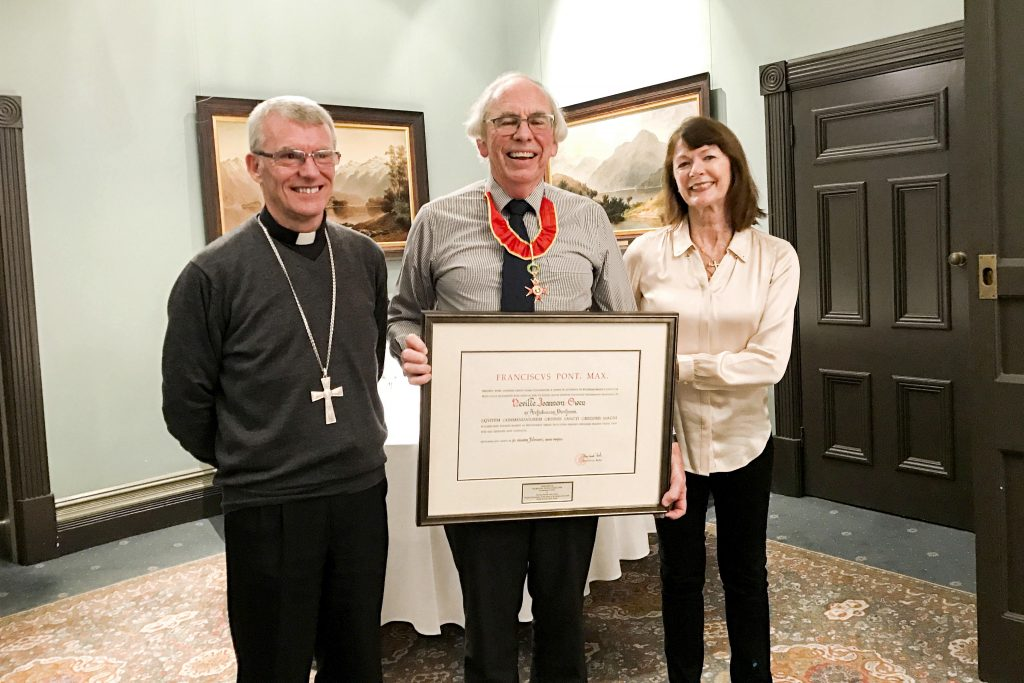 Perth Archbishop Timothy Costelloe SDB presents Justice Neville Owen with a Papal Honour of the Knight Commander of the Order of St Gregory the Great on behalf of His Holiness Pope Francis in June 2018. Photo: Supplied.