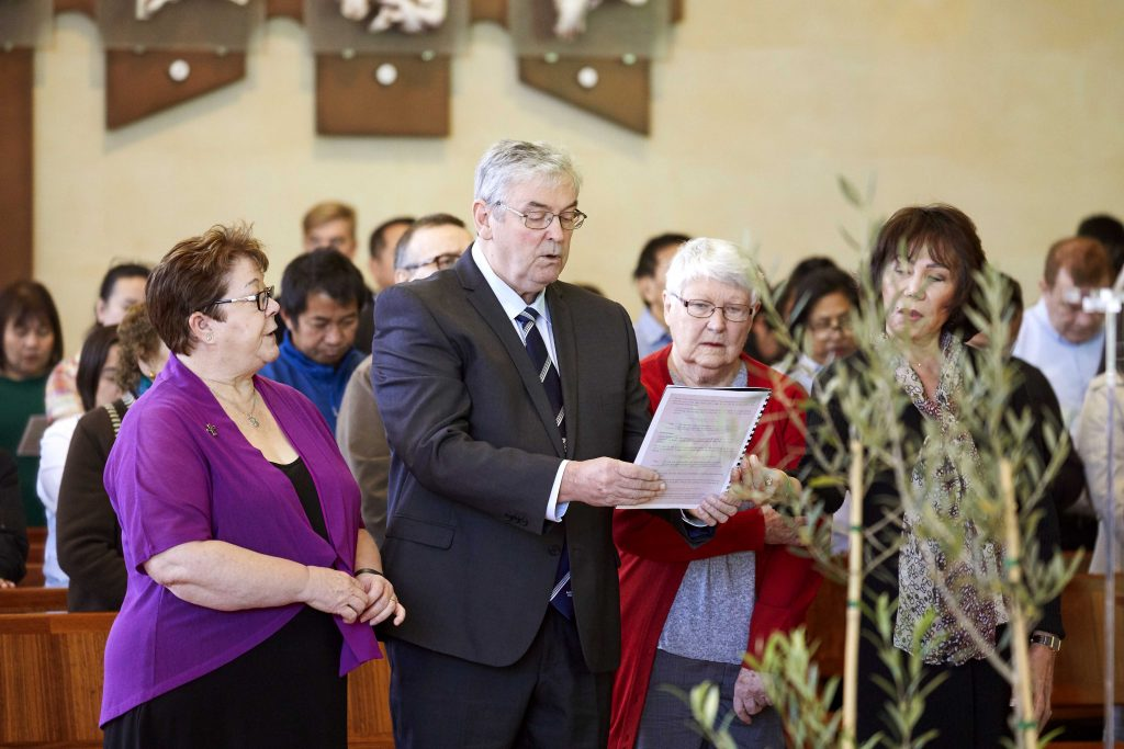 Centre for Liturgy Director Sr Kerry Willison RSM with Cathedral parishioners Don Hegarty, Kath Jacques, and Lolita Hegarty during Mass at St Mary's Cathedral, Sunday 2 June, marking the launch of the second phase of the 2020 Plenary Council. Photo: Ron Tan.