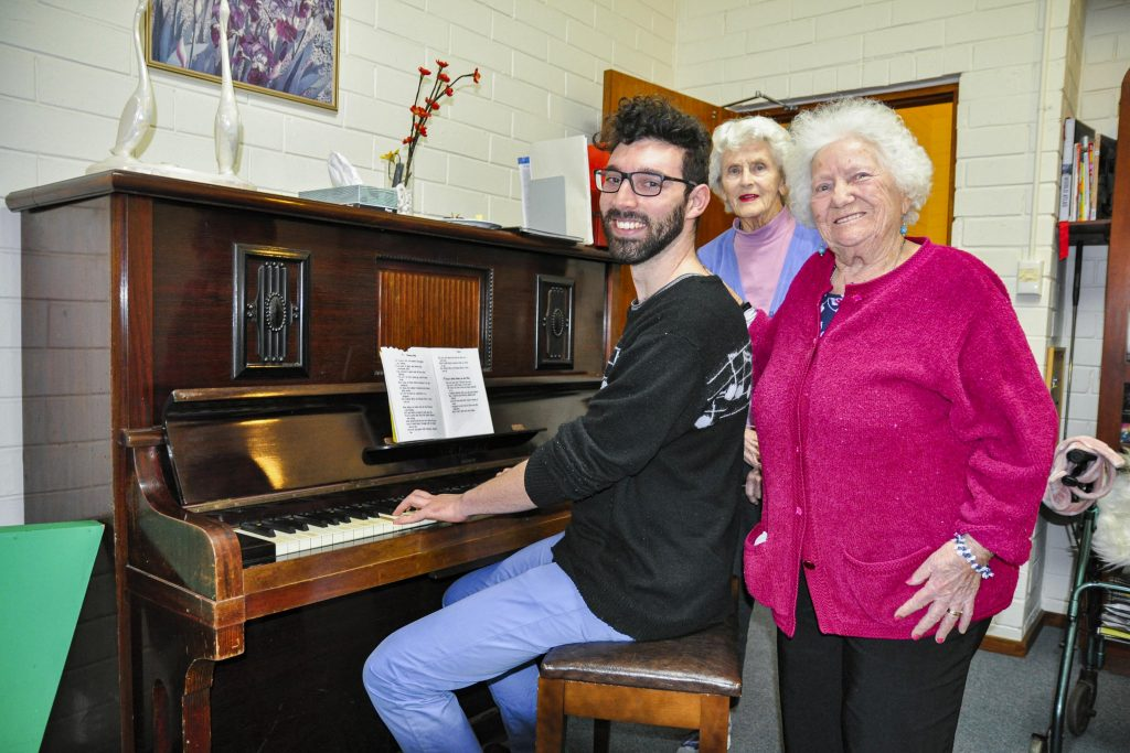 The dulcet tones that emanate from MercyVille's residential home each Friday afternoon come from volunteer Asher Caley, who has been singing at the home every week for the last six months. Photo: Supplied.