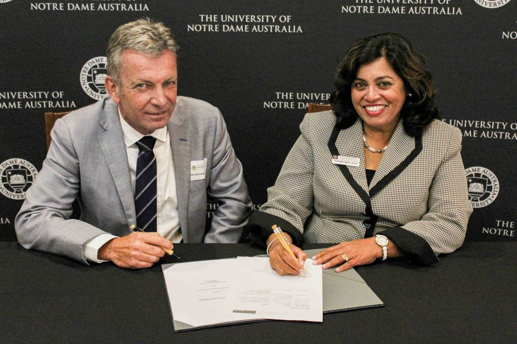 Fremantle Ports Chief Executive Chris Leatt-Hayter and UNDA Head of Fremantle Campus Prof Selma Alliex sign the MOU on Thursday 16 May. Photo: Supplied.