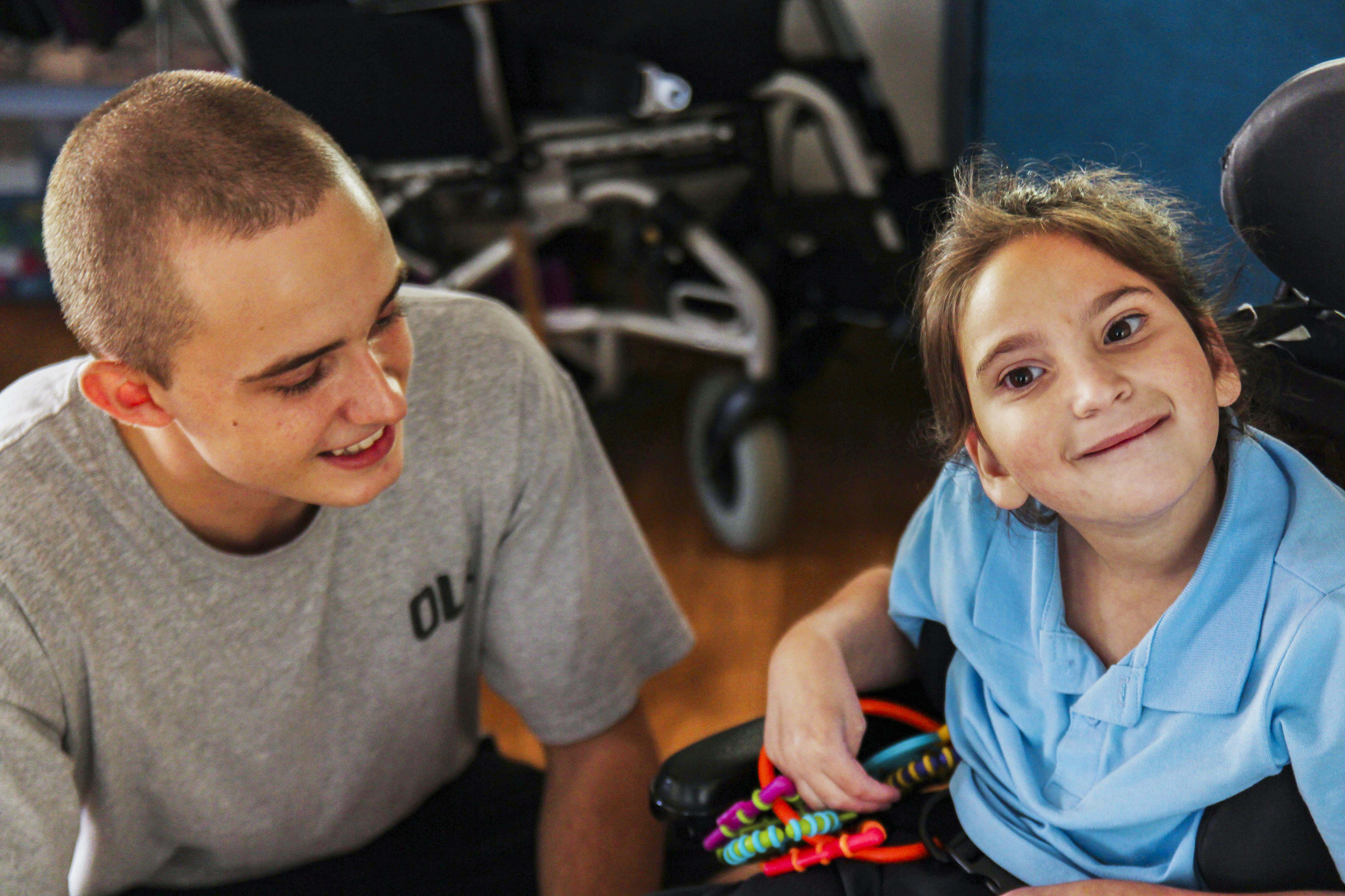 Identitywa support worker pictured with Olivia at the Riverton Children's House. Photo: Supplied.