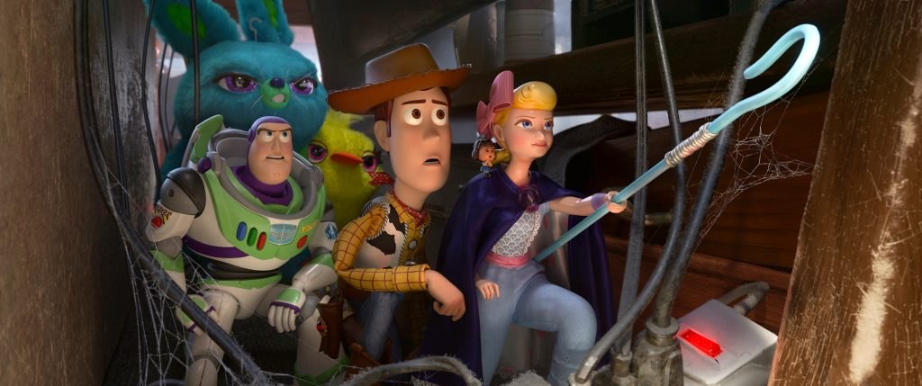 "Animated characters Buzz Lightyear (voiced by Tim Allen), Woody (voiced by Tom Hanks), and Bo (voiced by Annie Potts) appear in the movie ""Toy Story 4"". Photo: Disney/CNS."