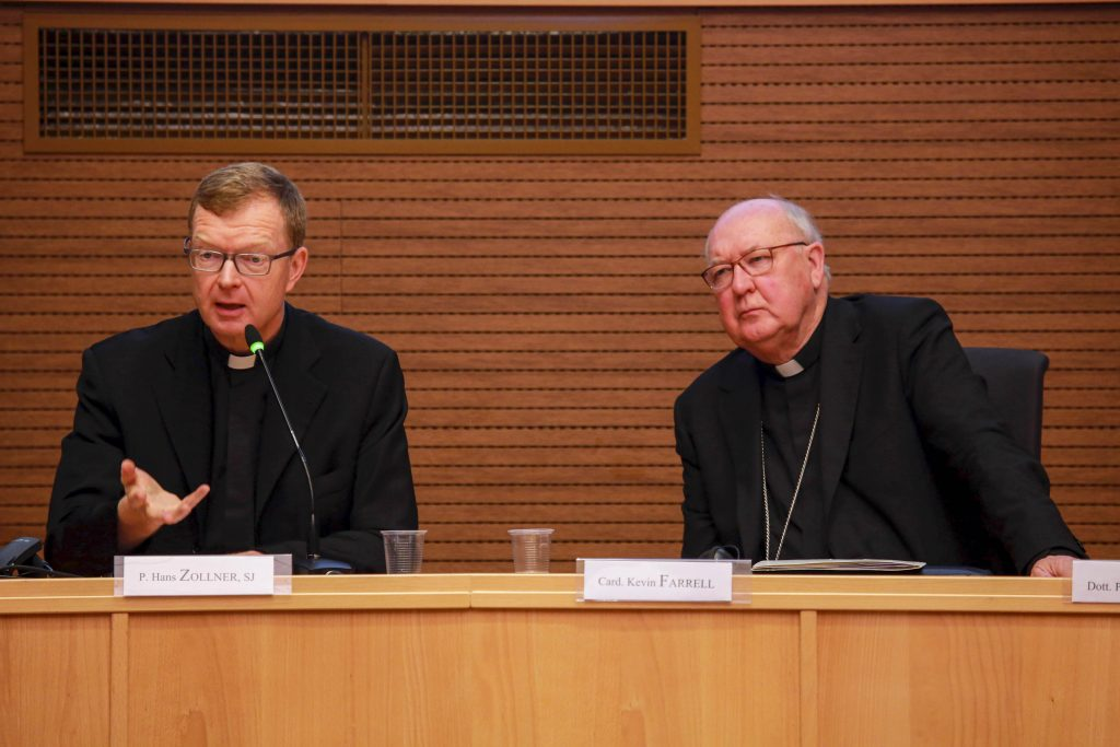 Jesuit Father Hans Zollner, president of the Centre for Child Protection at the Pontifical Gregorian University in Rome, and Cardinal Kevin J. Farrell, prefect of the Vatican's Dicastery for Laity, the Family and Life, participate in a meeting sponsored by the dicastery in Rome. Photo: Dicastery for Laity, Family and Life/CNS.