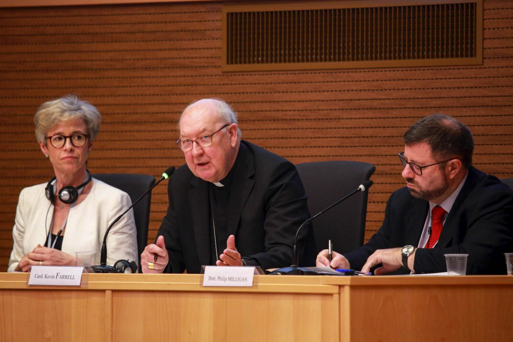 Cardinal Kevin J Farrell speaks during a meeting sponsored by the Vatican's Dicastery for Laity, Family and Life in Rome on 13 June 2019. At left is Linda Ghisoni, a canon lawyer who serves as a consultant for the Congregation for the Doctrine of the Faith; at right is canon lawyer Philip Milligan. Photo: Dicastery for Laity, Family and Life/CNS.