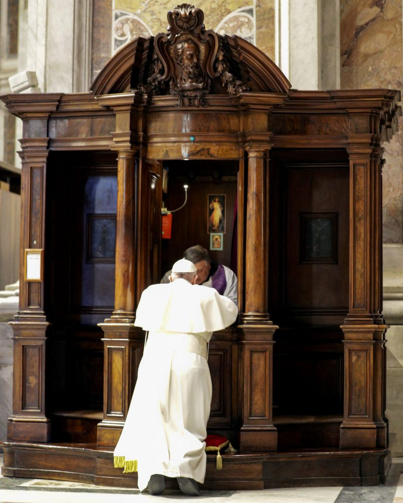 "A priest hears Pope Francis' confession during a Lenten penance service in St Peter's Basilica at the Vatican on March 29, 2019. In the light of ""a worrying negative prejudice"" against the Catholic Church, Pope Francis ordered the publication of a document affirming the absolute secrecy of everything said in confession and calling on priests to defend it at all costs, even at the cost of their lives. Photo: CNS/Andrew Medichini."