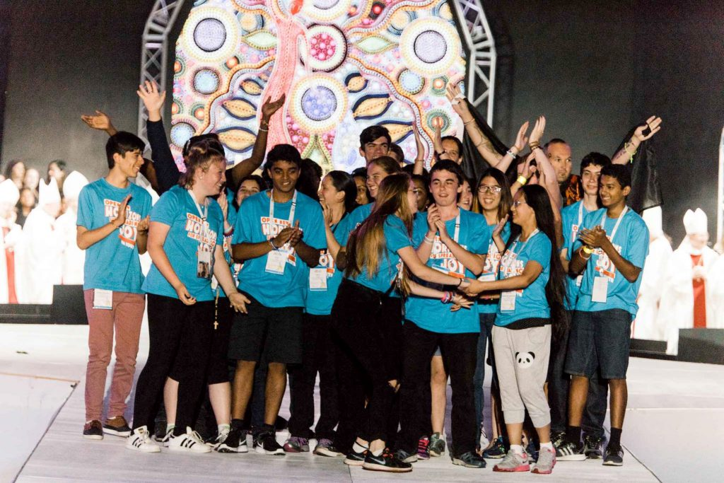 Young people celebrate on stage at the 2017 ACYF following the announcement that the next ACYF will be in held in Perth, from December 8 to 10. Photo: Cyron Sobrevinas.