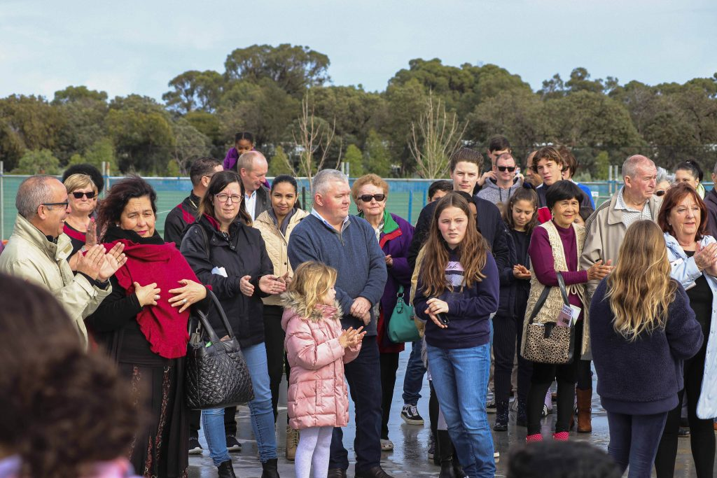 Parishioners stand on the foundation of their new upcoming Church after Mass on 7 July. Photo: Supplied.