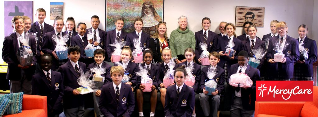 Mrs Louise Mason, Irene McCormack School Liaison Officer and Mrs Janice Bell Service Learning Coordinator with the Year 7 Evans House Students. Photo: Supplied.