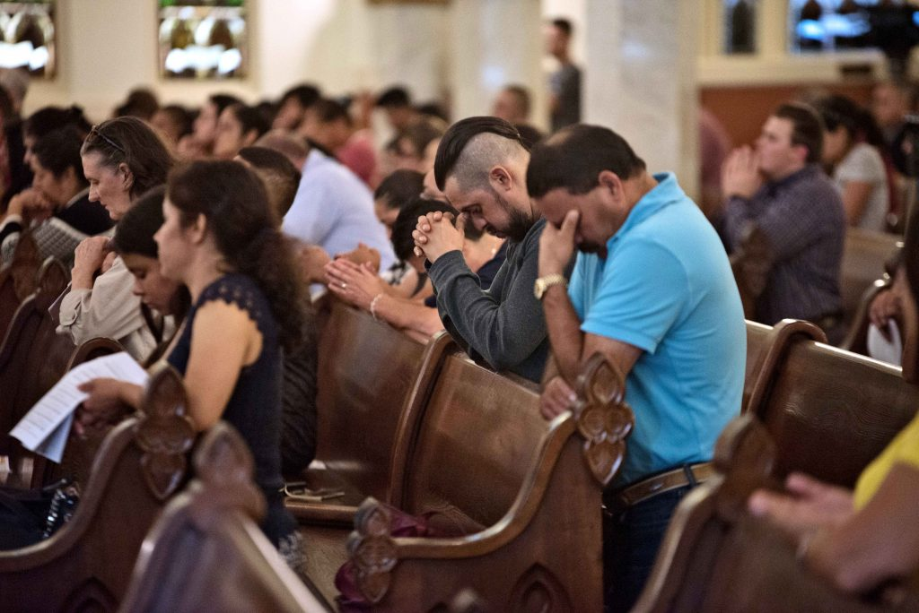 People pray during a healing Mass on 7 August 2019 at the Cathedral Shrine of the Virgin of Guadalupe in Dallas for the 31 victims killed in the mass shootings in El Paso, Texas, and Dayton, Ohio, on 3 and 4 August. Photo: Jenna Teter/The Texas Catholic.