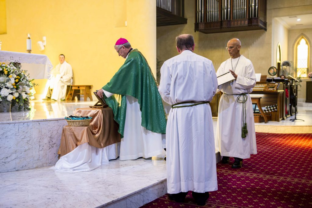 Archbishop Timothy Costelloe SDB blesses the plaque commemorating St Patrick's 25th anniversary as an ecclesiastical basilica. Photo: Eric Martin.
