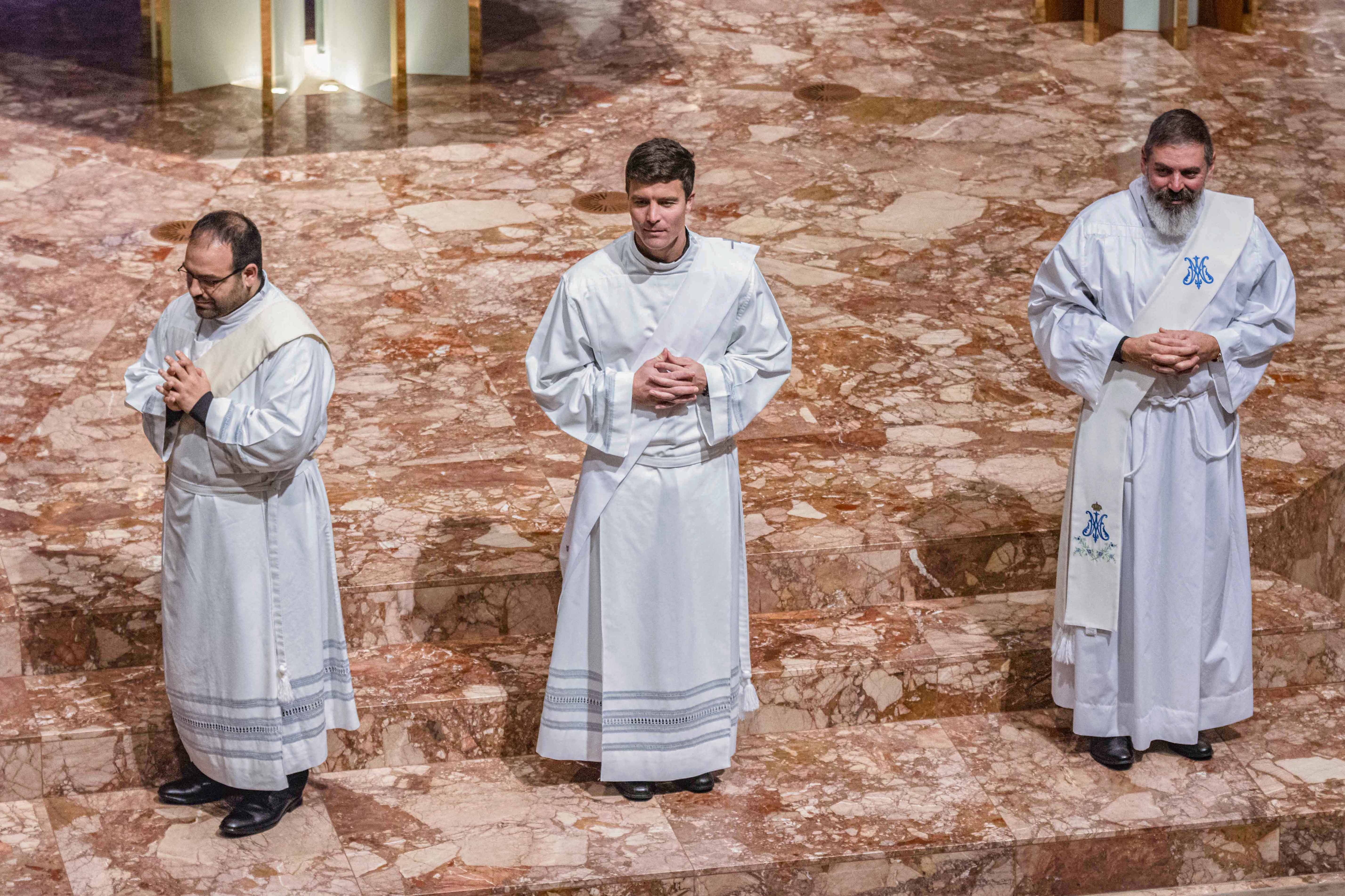 Fr Matteo Verdi, Fr Liam Ryan, and Fr Mark Rucci during their Ordination to the Priesthood on 16 August at St Mary's Cathedral. Photo: Matthew Lau.