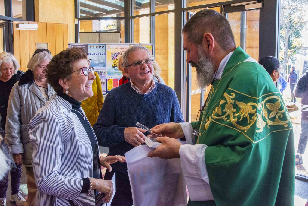 Parishioners of St Benedict's Church in Applecross greet the recently ordained Fr Mark Rucci on 18 August. Photo: Matthew Lau.