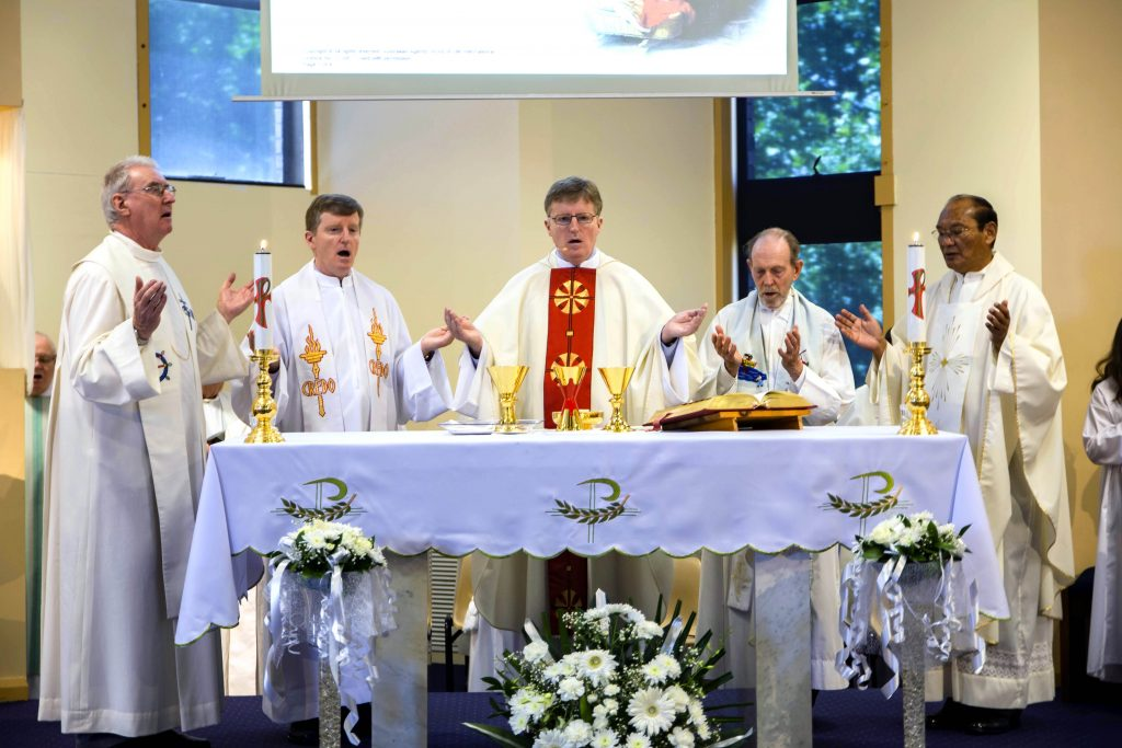 Fr Peter Toohey (second from right) celebrates the Eucharist on Sunday 4 November 2018 for the Columban Missionaries' centenary at Como Parish. Photo: Matthew Lau.