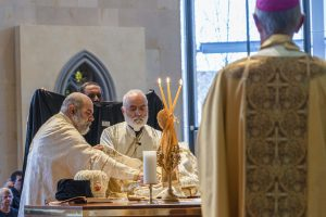 Bishop Rabbat is vested at the altar, assisted by Fr Elias Kilzi. Photo: Josh Low.