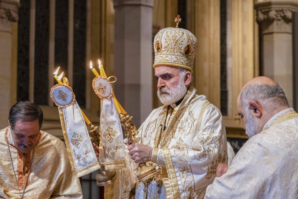 At the conclusion of the liturgy on 23 August, Bishop Rabbat offers the Bishop's Blessing with the Dikirion in his right and Trikirion in his left hand, candles which represent the divinity and humanity of Christ, and the Holy Trinity respectively. Photo: Josh Low.
