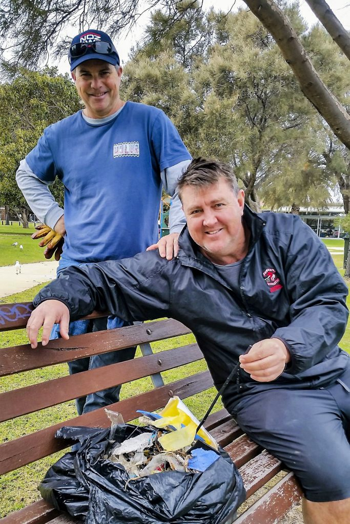 Jason Edmunds and Mark Pavy volunteered at the East Fremantle River clean-up efforts as part of the Seton Staff Community Service Day which was held for the first time on 22 June. Photo: Seton Catholic College.