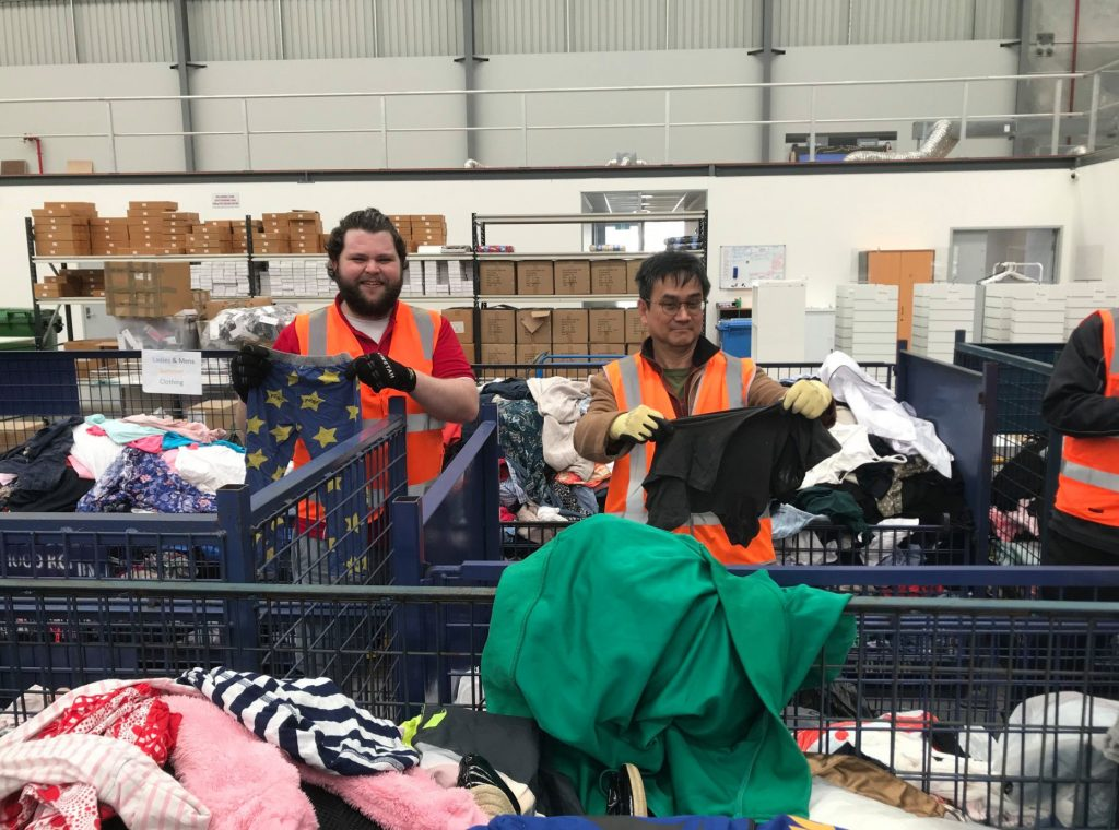 Dane Ehrlich and Hui Bin Loh working at St Vincent de Paul Society as part of the Seton Staff Community Service Day, which was held for the first time on 22 June. Photo: Seton Catholic College.