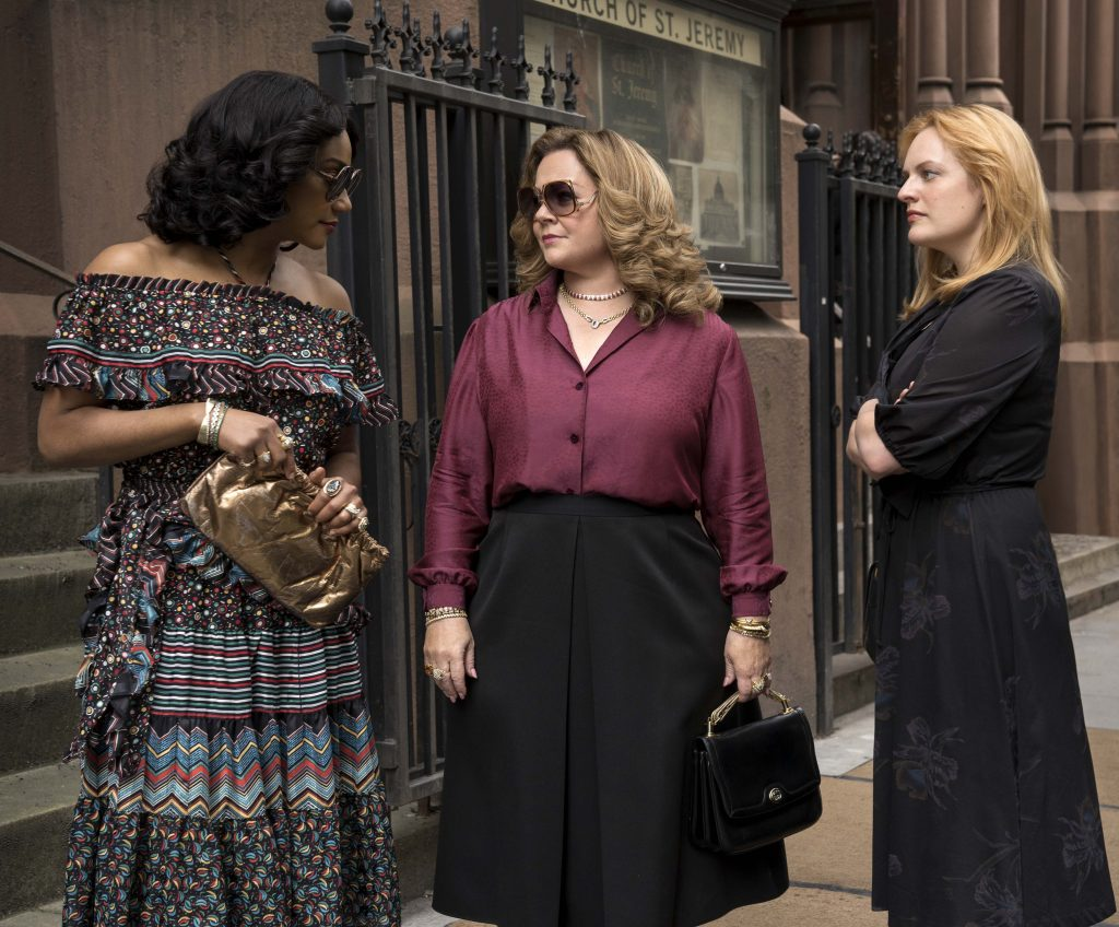 """Tiffany Haddish, Melissa McCarthy, and Elisabeth Moss star in a scene from the movie """"The Kitchen"""". Photo: Warner Bros/CNS."""