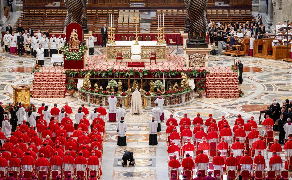 Pope Francis prays as he arrives for a consistory to create new cardinals in St. Peter's Basilica at the Vatican in this 28 June 2017 file photo. The Holy Father announced on 1 September that he would create 13 new cardinals at a 5 October consistory. Photo: Paul Haring/CNS.
