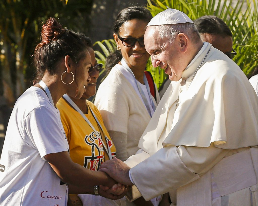 Pope Francis urged the local church and government to make greater efforts to listen to and involve the island's young people in every aspect of life. Photo: Paul Haring/CNS.
