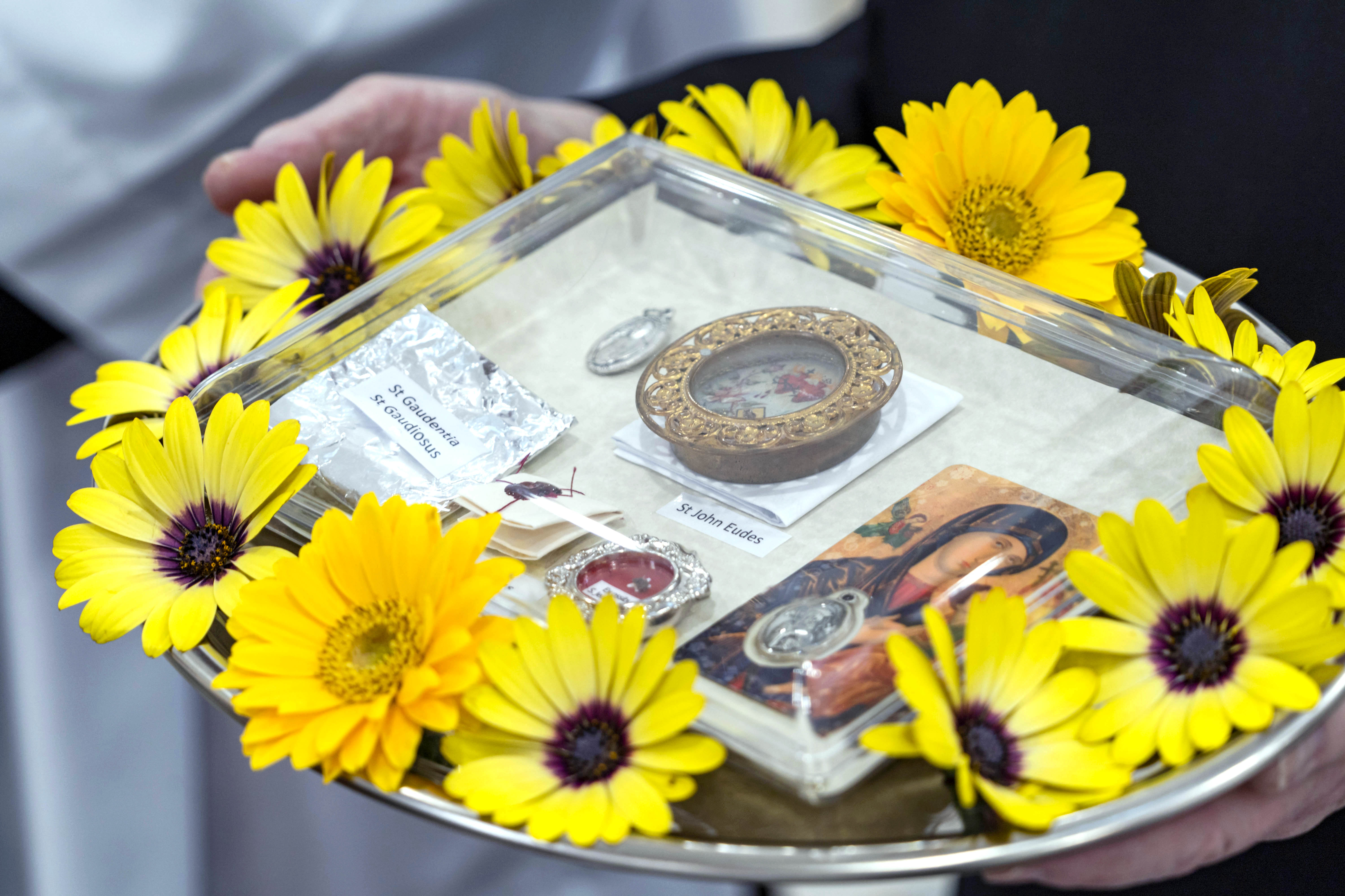 The sacred relics, ready to be sealed within the altar as part of the consecration ceremony. Photo: Josh Low.