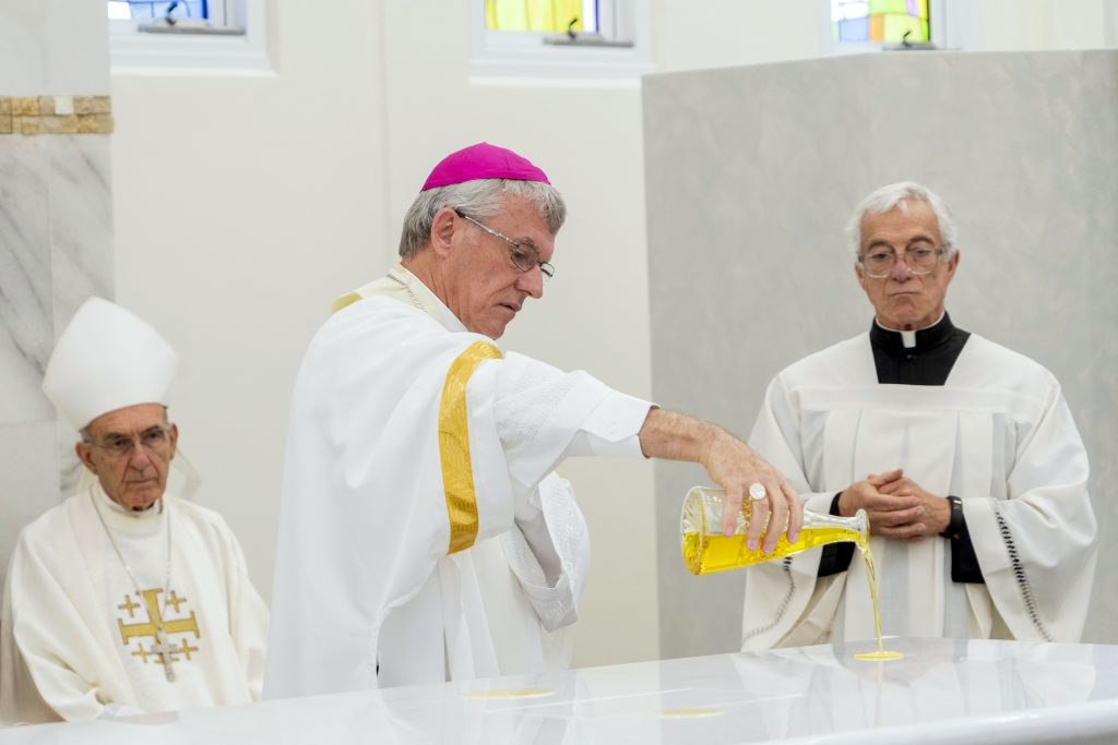 Archbishop Timothy Costelloe anoints the Altar with sacred oil. Photo: Josh Low.