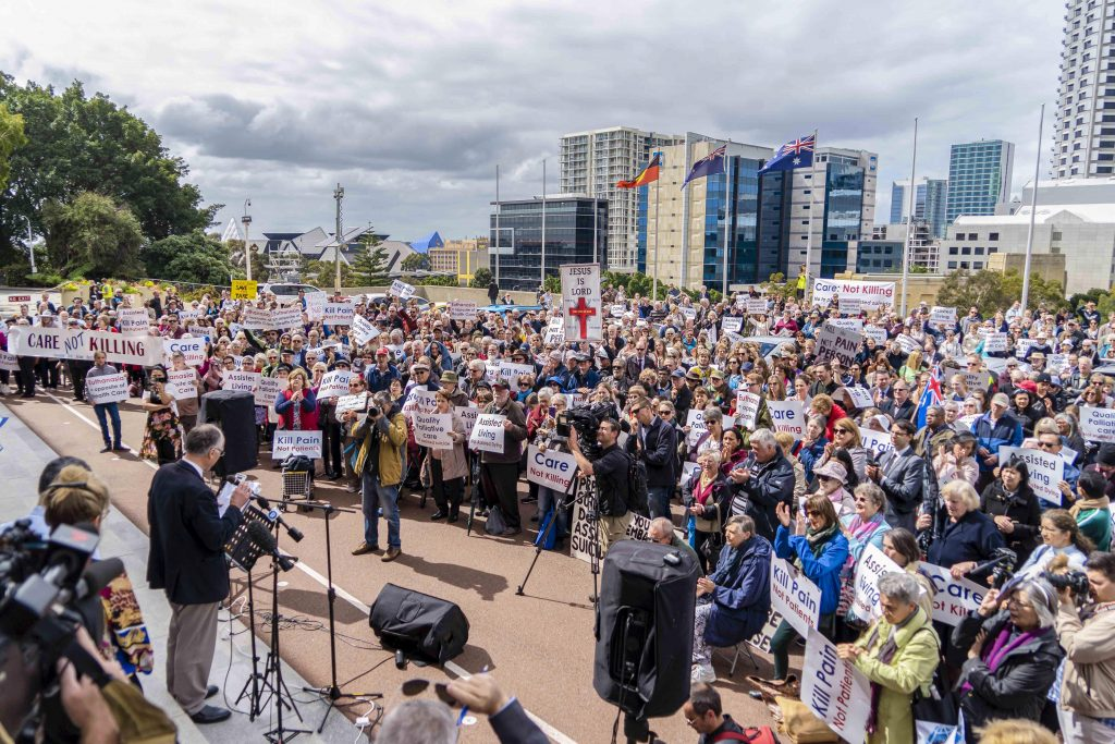 Protestors and supporters gather peacefully outside Parliament House for the 12 noon CARE: Not Kill rally on Wednesday, 4 September. Photo: Josh Low.