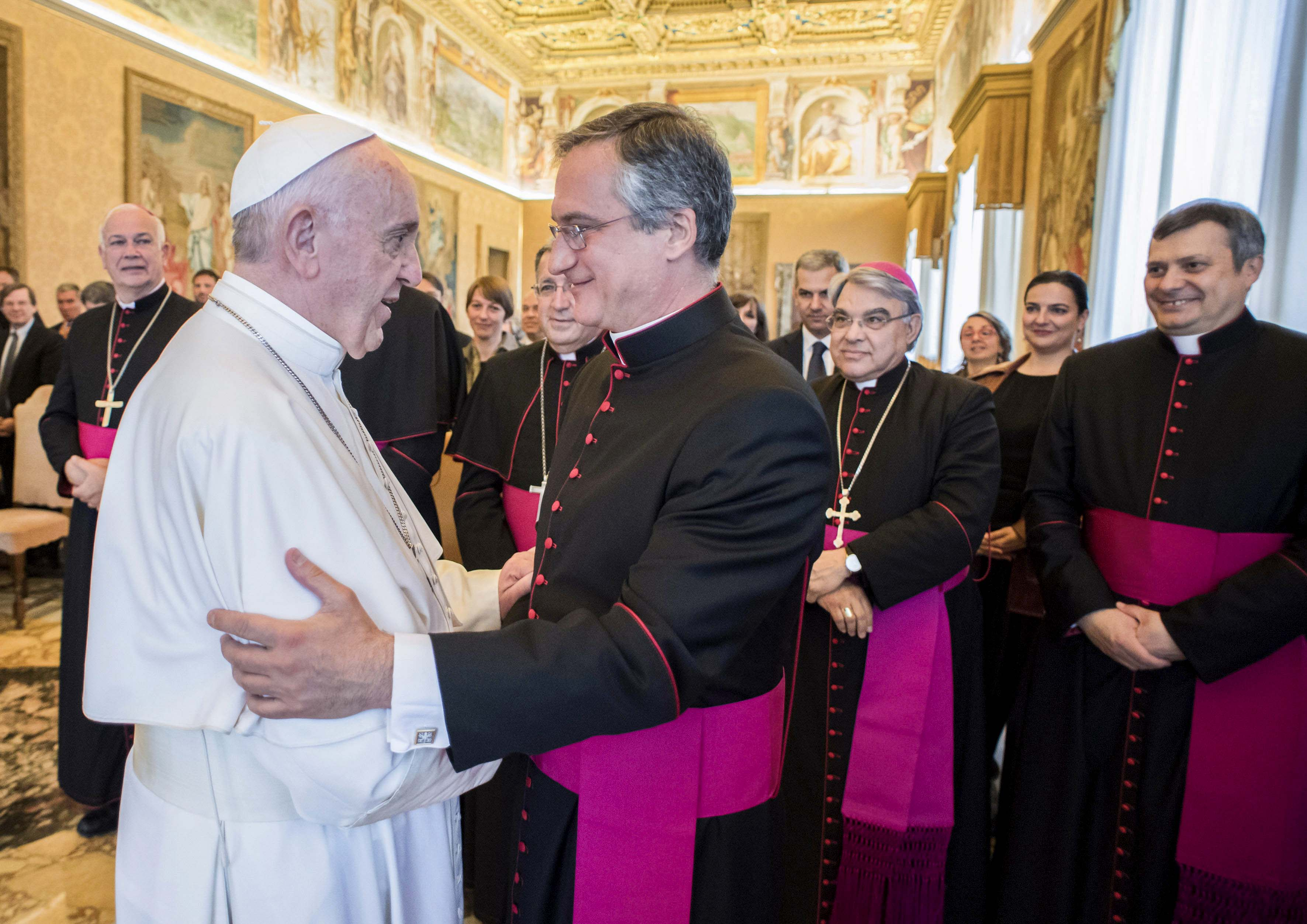 Pope Francis greets Msgr Dario Vigano, Director of the Vatican Secretariat for Communications, during a meeting with members of the Secretariat at the Vatican May 4. Addressing the group responsible for reforming Vatican Communications, the Holy Father said that courageous teamwork is needed to best respond to new challenges. Photo: CNS/L'Osservatore Romano.