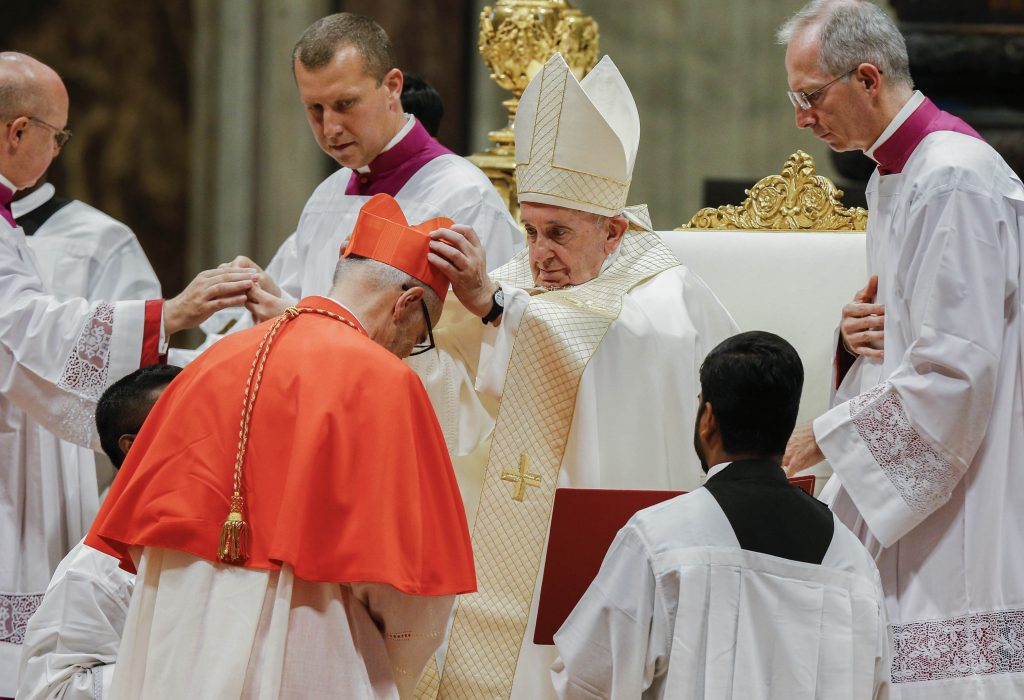 Pope Francis places a red biretta on new Canadian Cardinal Michael Czerny during a consistory for the creation of 13 new cardinals in St Peter's Basilica at the Vatican on 5 October 2019. Photo: Paul Haring/CNS.