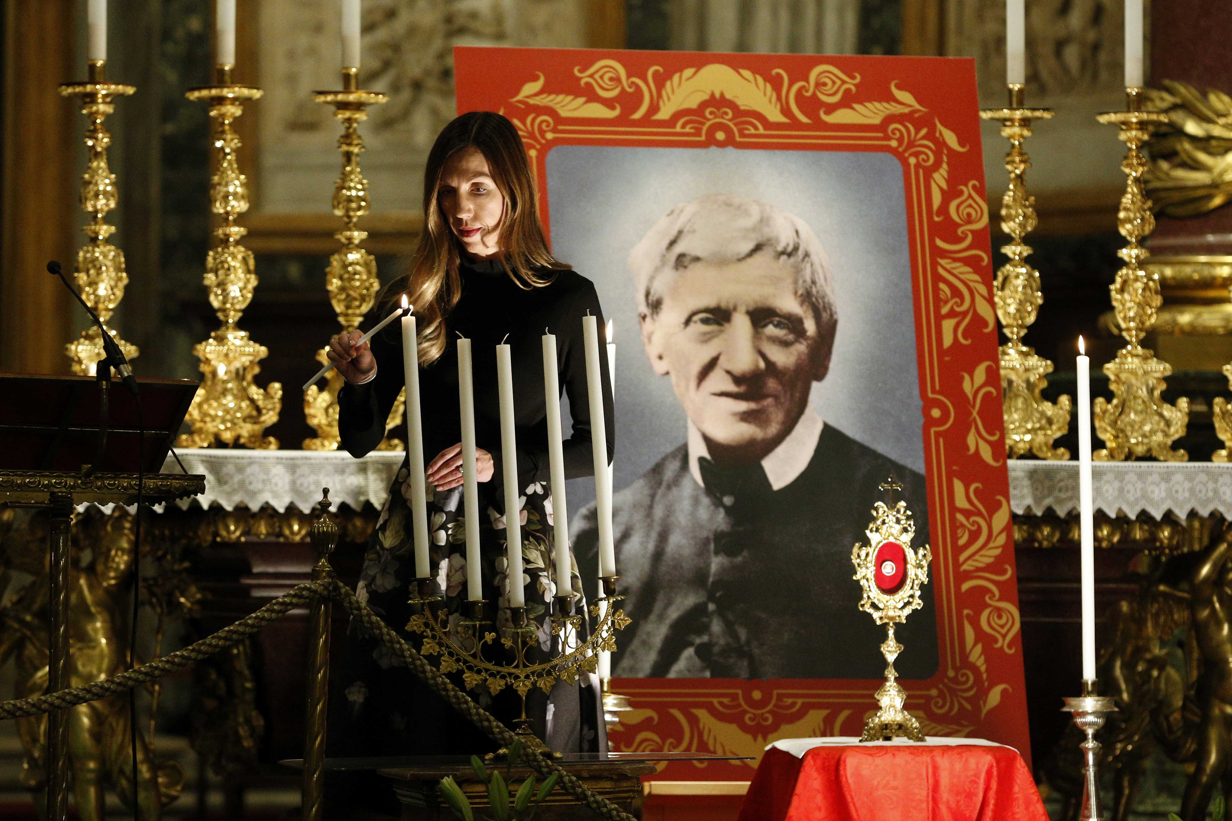 Melissa Villalobos of Chicago lights a candle during a vigil in advance of the canonisation of St John Henry Newman, at the Basilica of St Mary Major in Rome on 12 October 2019. Villalobos' healing through the intercession of St John Henry Newman was accepted as the miracle needed for the British cardinal's canonisation. Photo: Paul Haring/CNS.