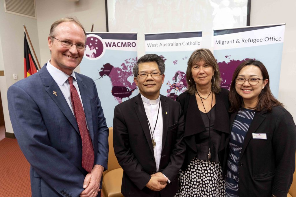 West Australian Catholic Migrant and Refugee Office Director Deacon Gregory Lowe, Bishop Vincent Long Van Nguyen, MercyCare Corporate Partnership Manager and interviewer for the event Geraldine Mellet and WACMRO staff Grace Kurniawan at the conclusion of the event held on 3 October at the University of Notre Dame Fremantle Campus. Photo: Josh Low.