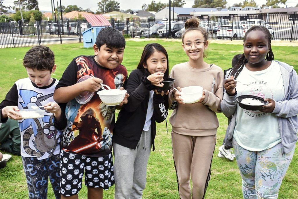 Students at St Jude's Catholic Primary School arrived at school in pyjamas for Rice Day. Photo: Supplied.