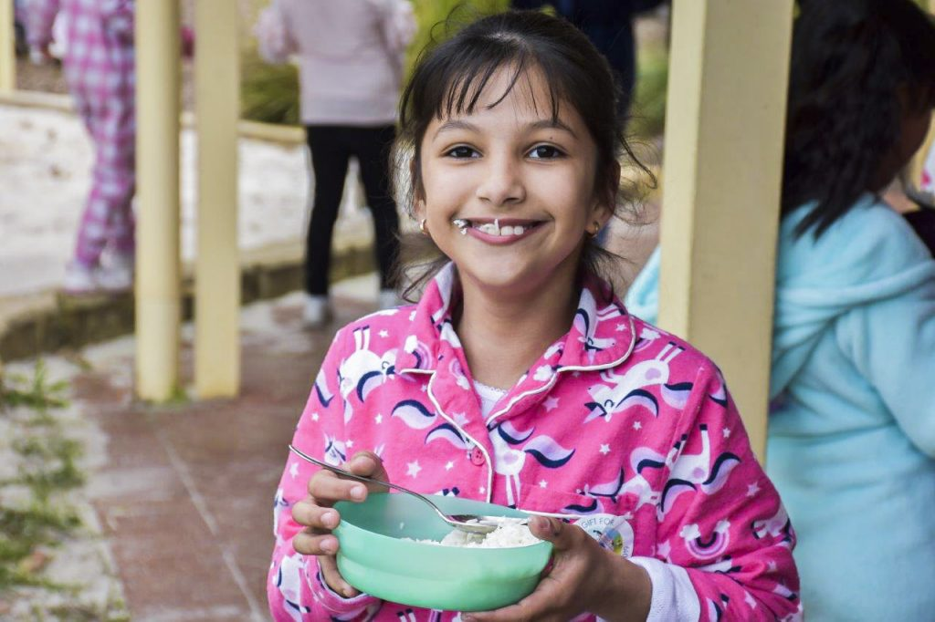 Students held off eating their normal food on Rice Day, given just one bowl of rice – globally considered as the day's full feed. Photo: Supplied.