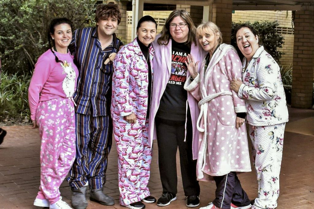 Not to be outdone by their students, staff at St Jude's Catholic Primary also don pyjamas for Rice Day. Photo: Supplied.